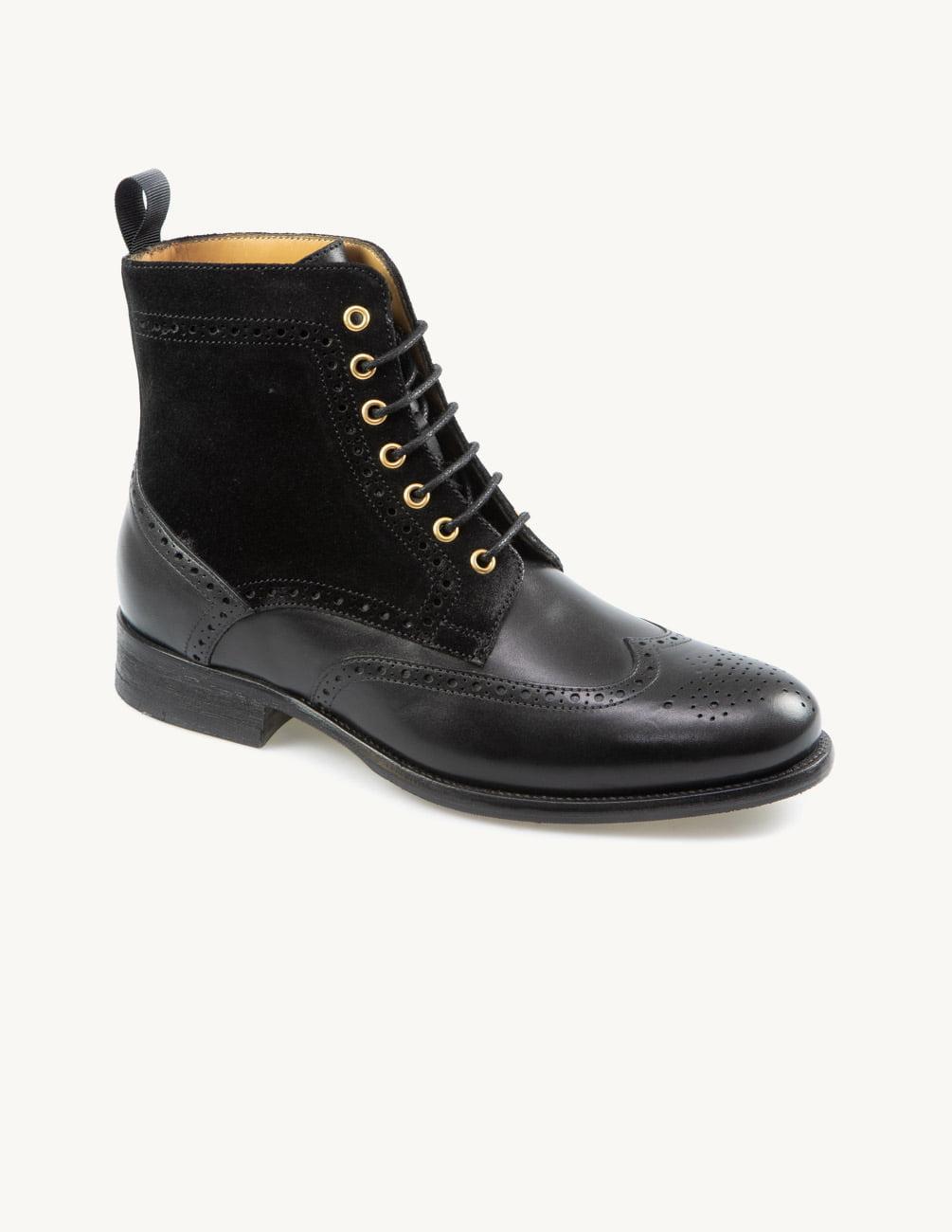 O melhor investimento: botins pretos rasos de senhora em pele de vitela, design clássico